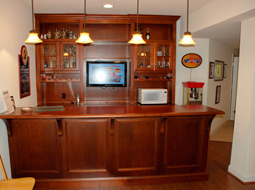 Custom Maple Bar and cabinets with TV installed